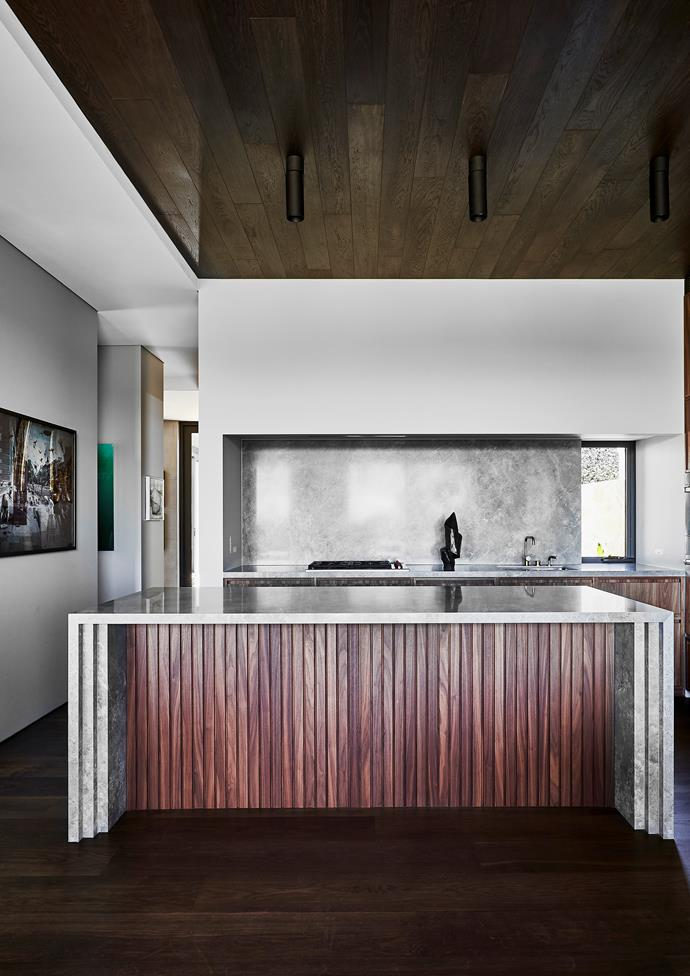Eterno tongue-and-groove oak floorboards in custom stain.  Joinery and ceiling in American walnut. Maximum 'Fior Di Bosco' panels from Artedomus continue on bench surfaces and splashback. Holon downlights from Kreon. Sculpture by Peter Lundberg. Photograph by Michael Cook.
