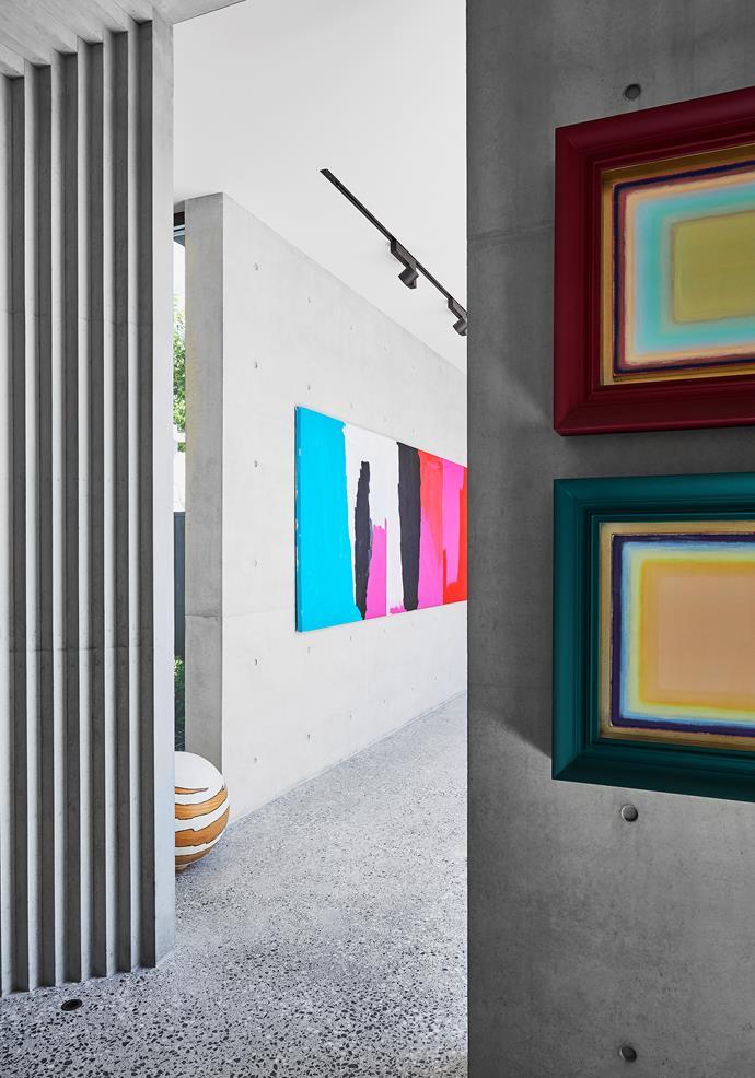 Looking from the entryway towards the corridor gallery. Pair of artworks on near wall by Tomislav Nikolic. Triptych artwork in corridor by Mirdidingkingathi Juwarnda Sally Gabori.