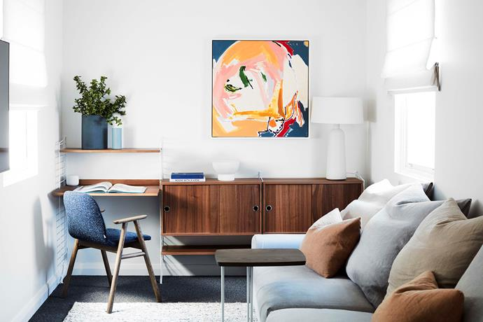 Vibrant art graces the wall in the study nook. String walnut desk and shelving system, Great Dane Furniture. Vista sofa and Nash table, Jardan. Artwork by Kerry Armstrong.