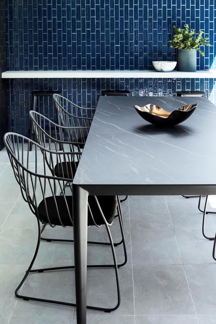 Glossy navy subway. tiles have a different energy when laid in a vertical pattern.