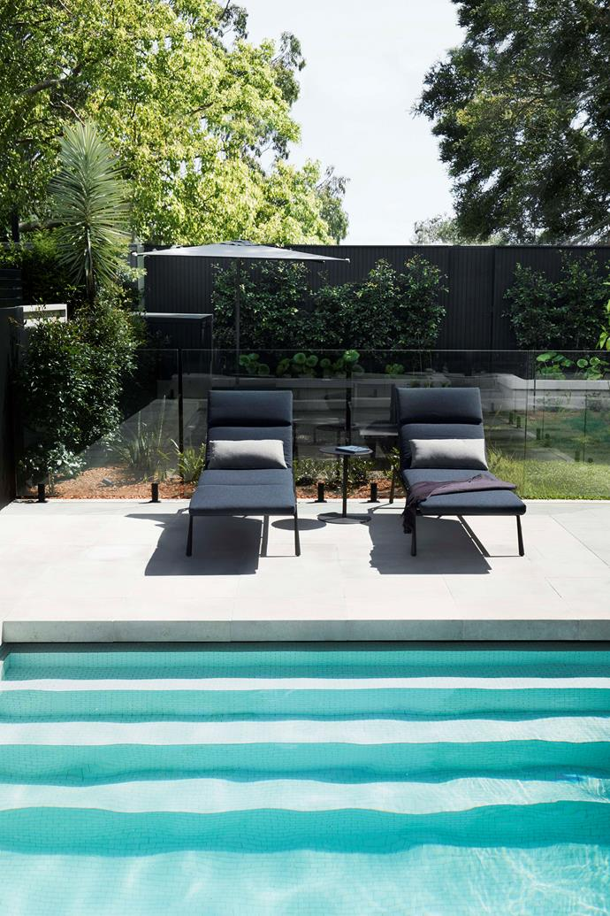 Branch loungers from Cosh Living are ideal for hanging out. The pavers are tumbled limestone, supplied by Pepo Botanic Design.