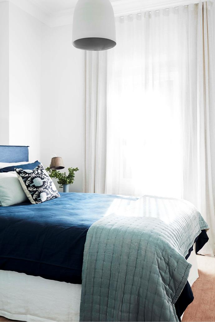 """In the guest bedroom, a Willow bedhead from Bedsnest sets the style. Bedding from In The Sac. """"I absolutely love the blues. They create such a wonderful ambience,"""" says Renee."""
