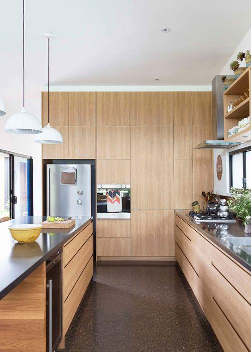 The kitchen has plenty of storage, with cupboards running the length of the space. The cabinetry is Laminex 'Sublime Teak' woodgrain laminate in Natural, Scribe Joinery.