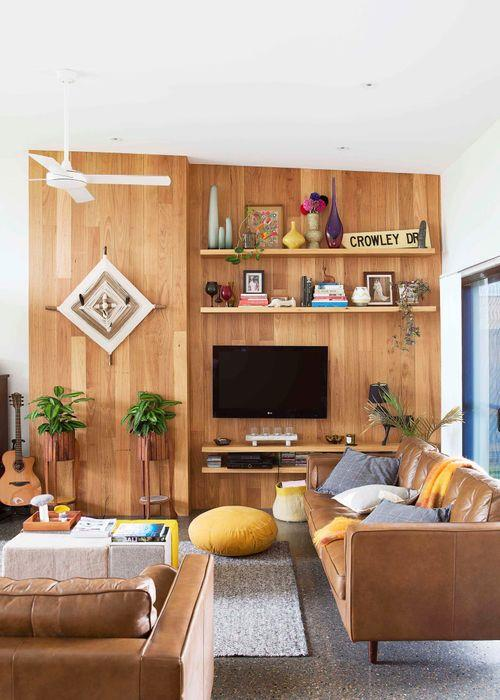 """Radiating retro cool, Oregon timber forms a focal point in the relaxed living area. With a strong love for natural surfaces, homeowners designed the feature wall themselves. In line with the rest of the renovation, recycled timber was used; for similar, try Ebay or a reclaimed timber specialist such as [Ironwood](http://www.ironwood.com.au target=""""_blank"""" rel=""""nofollow"""")."""