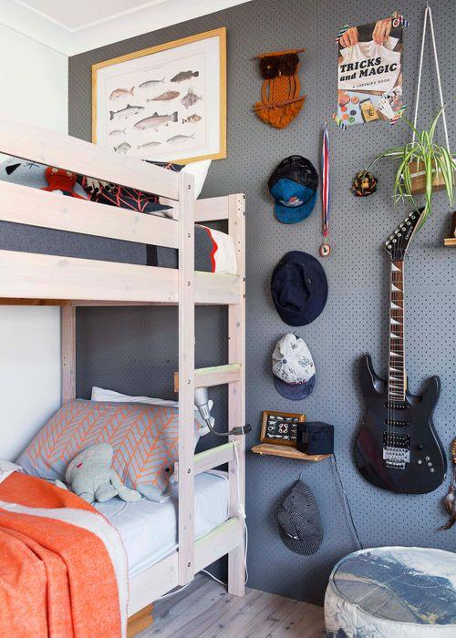 An Ikea 'Mydal' bunk bed was whitewashed by Nicky and dressed in Pony Rider blankets and throws.