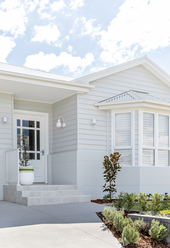 """Although estate regulations did not allow their original plan - to clad the entire facade, Heather and Sarah created a [country-style home exterior](https://www.homestolove.com.au/home-exteriors-best-of-country-style-19179 target=""""_blank"""") with a combination of rendered and clad materials."""