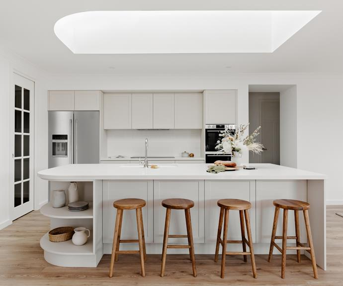 The curved island bench is spectacularly mirrored in shape in the skylight above.
