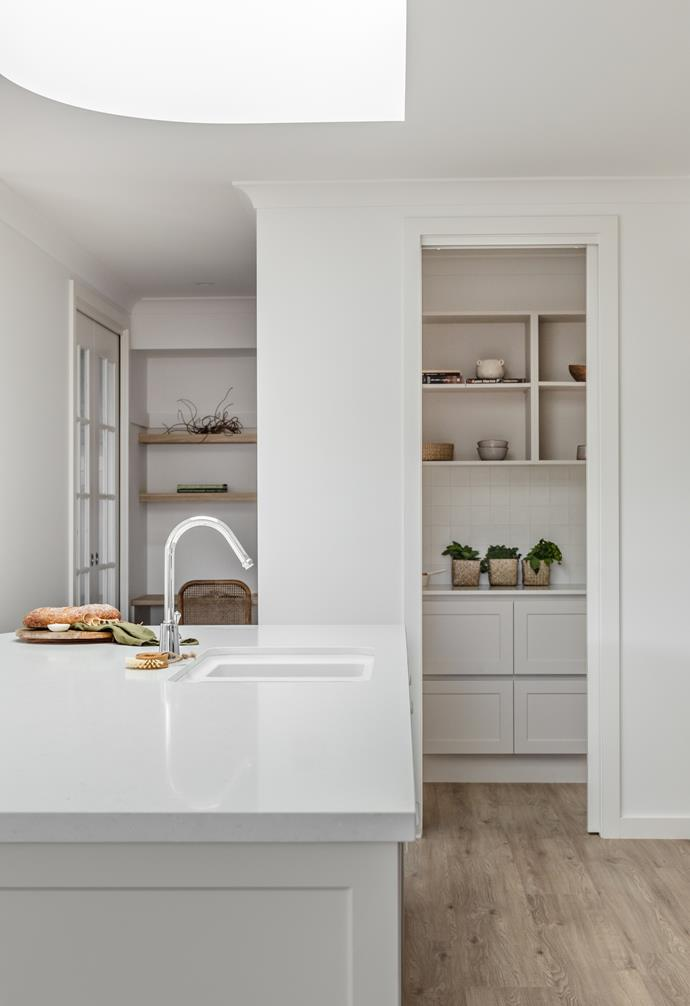 """They were told by their real estate advisors that buyer prioritise storage when looking for a home,  so the Oak and Orange team added a butler's pantry for [extra kitchen storage](https://www.homestolove.com.au/kitchen-storage-solutions-6078 target=""""_blank"""")."""