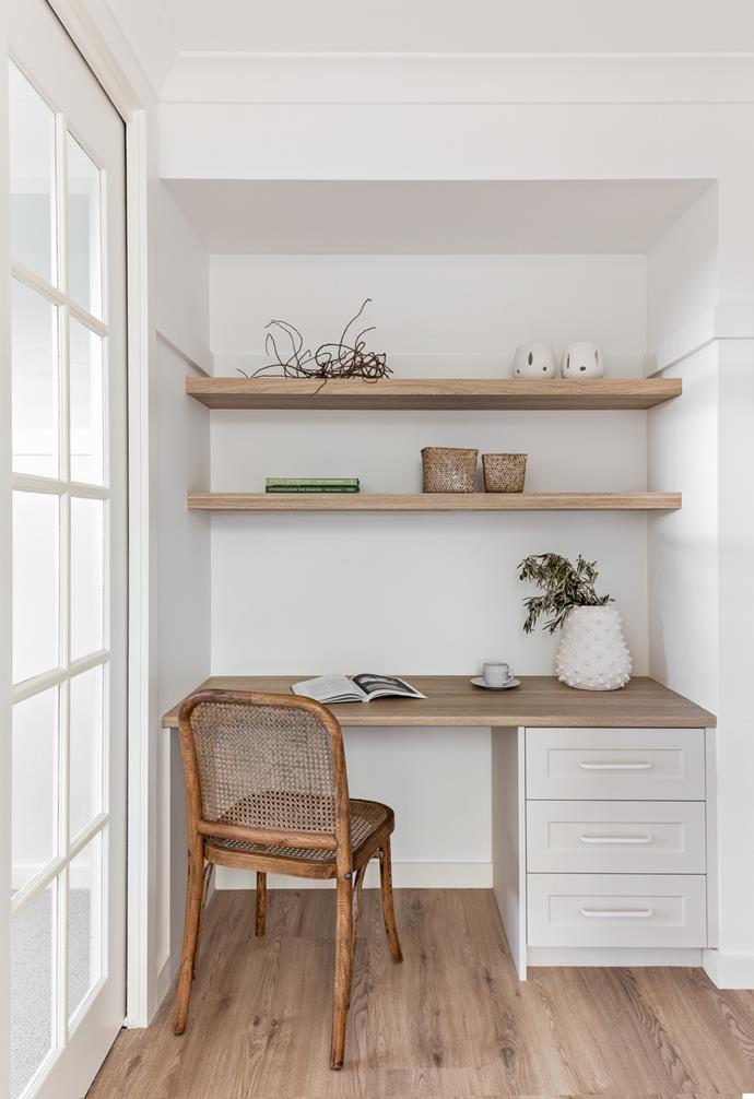 A stylish home office corner in the hallway is a practical edition.