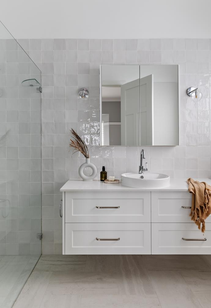 The ensuite to the master bedroom is another fresh white and textural space with plenty of practical storage.
