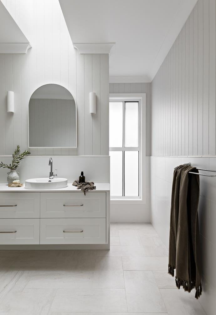 """An [arched mirror](https://www.homestolove.com.au/arched-mirrors-australia-22180 target=""""_blank"""") brings contemporary, Mediterranean-style to the family bathroom."""
