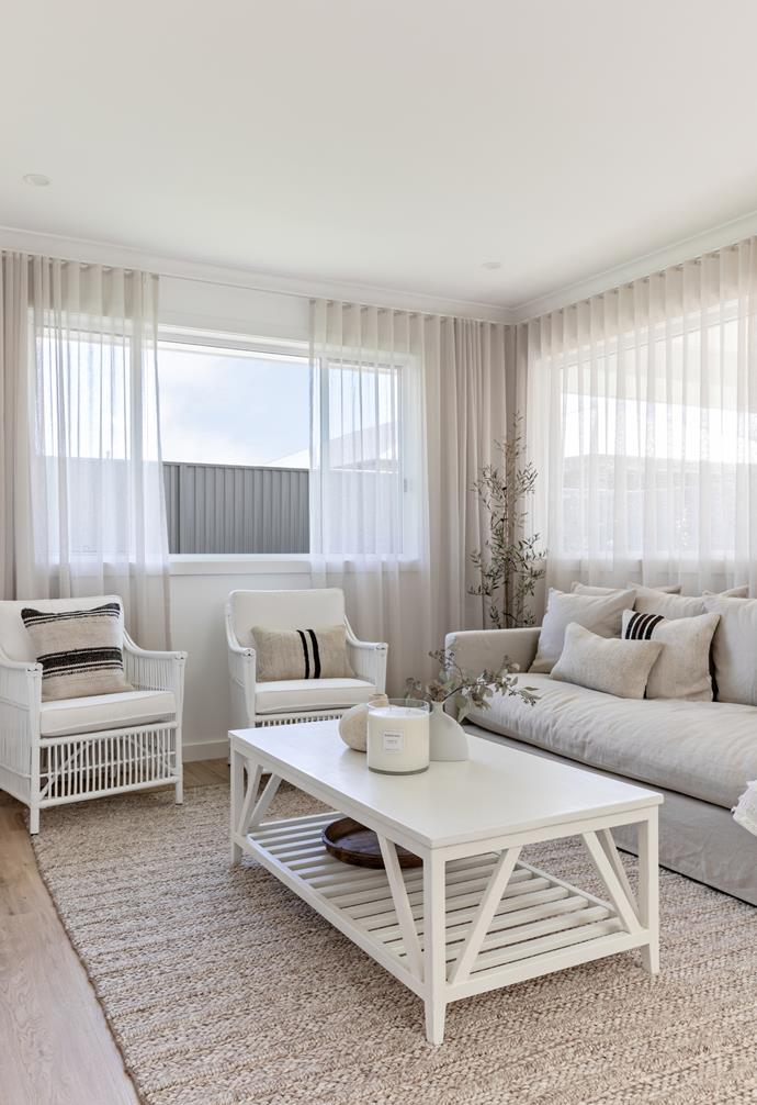 White and neutral hues in the family living area continue the airy, spacious feel throughout the home.