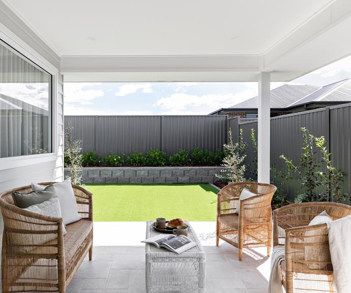 The outdoor sitting area is accessed by sliding doors from the open-plan kitchen and living space, making it ideal for entertaining all year round.