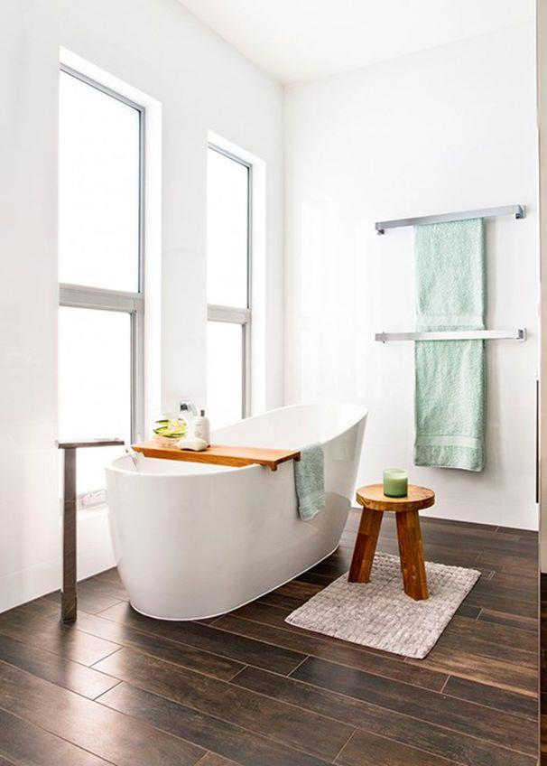 **Hotel glamour**<br><br> Hotel-like luxury is brought into this simple, streamlined space via the glamorous freestanding bath. The tall windows bring in lots of natural light, while the floorstanding bathfiller adds a sculptural element.