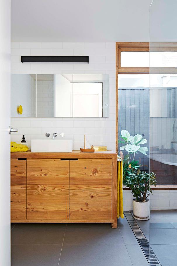 **Family-friendly abode**<br><br> A simple glass panel separates the shower zone from the rest of the room, containing splashes without creating a visual divide. The design feature also allows the eye to travel through the room, enhancing the sense of space.