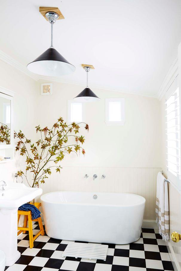 **Lights fantastic**<br><br> A gorgeous, freestanding bath gives this room its focal point, offset by a classic chequerboard scheme on the floor and elegant pendants.