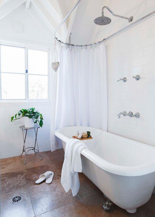 **Beachside bliss**<Br><br> Proving that a small bathroom needn't be less than stylish, an overhead shower is positioned over the bath, with the all-white scheme radiating serenity.