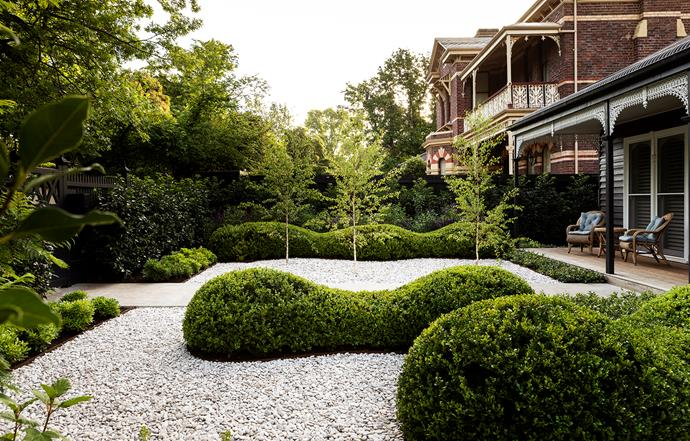 Bethany Williamson swapped lawn for white pebbles and sculpted undulating mounds of evergreen buxus which sit like dramatic islands of greenery amid the white. Offsetting the solid-looking mounds she planted slender-trunked silver birch trees (Betula pendula) and a bed of purple-flowering perennials, ensuring the garden is one of balance and contrast. White pebbles from Rock&Stone Outdoor Living.