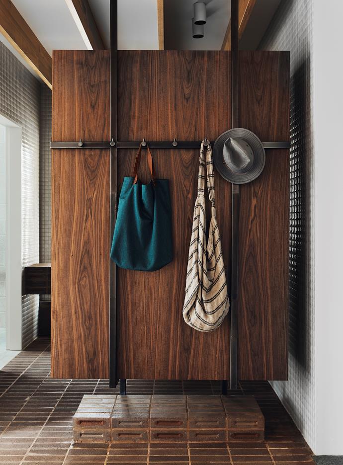 Linen cupboard finished in American walnut veneer with custom steel frame and Brodware 'Yokato' robe hooks.