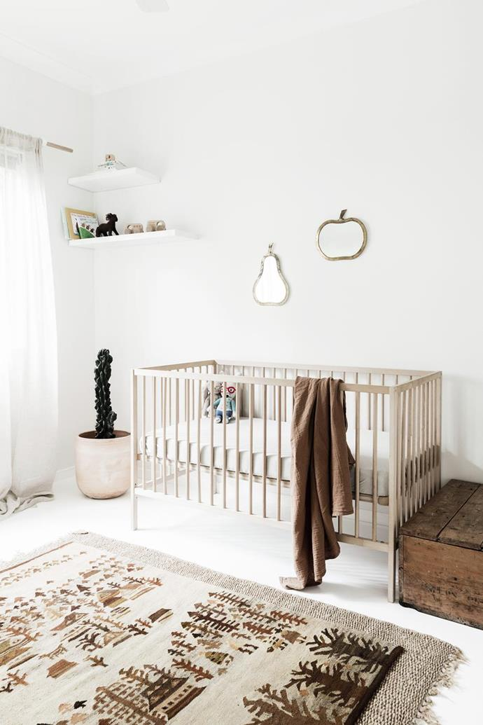"""The decor in this nursery is kept simple and considered to create a serene, clutter-free space in this [relaxed Byron Bay home](https://www.homestolove.com.au/a-byron-bay-home-filled-with-handcrafted-finds-19045