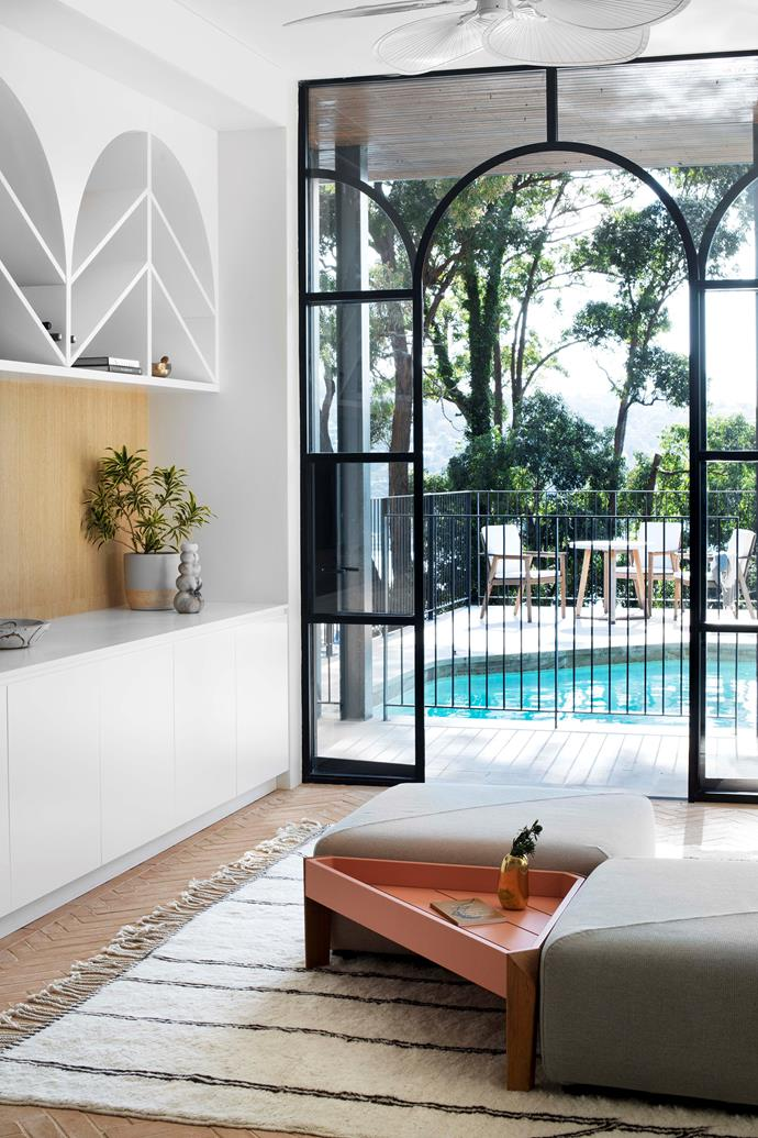 This shot shows the cabana room's proximity to the pool and shelving inspired by the family's travels in India. Steep doors by Award Architectural Aluminium. Custom cabinetry, VRD Detailed Joinery. Terracotta floor tiles, Eco Outdoor.