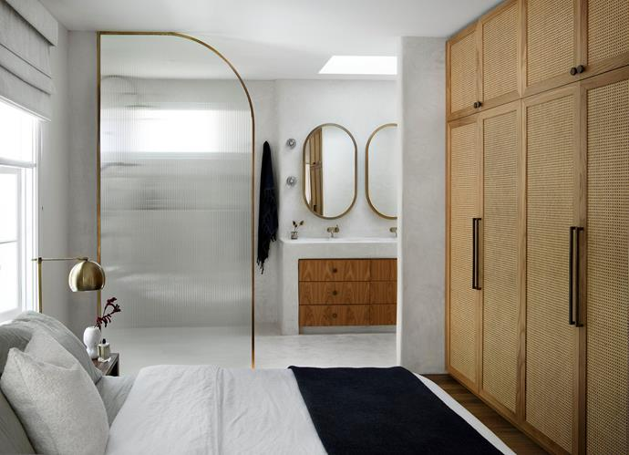 """""""Our bathroom feels like stepping into an old Turkish spa,"""" says Angela of the lime-based rendered space by Tadelakt Sydney. """"The Tadelakt is appplied by hand and has a soft leathery feel to it. This room is full of curves and rounded edges, and using the open twin shower is such a luxurious experience."""""""
