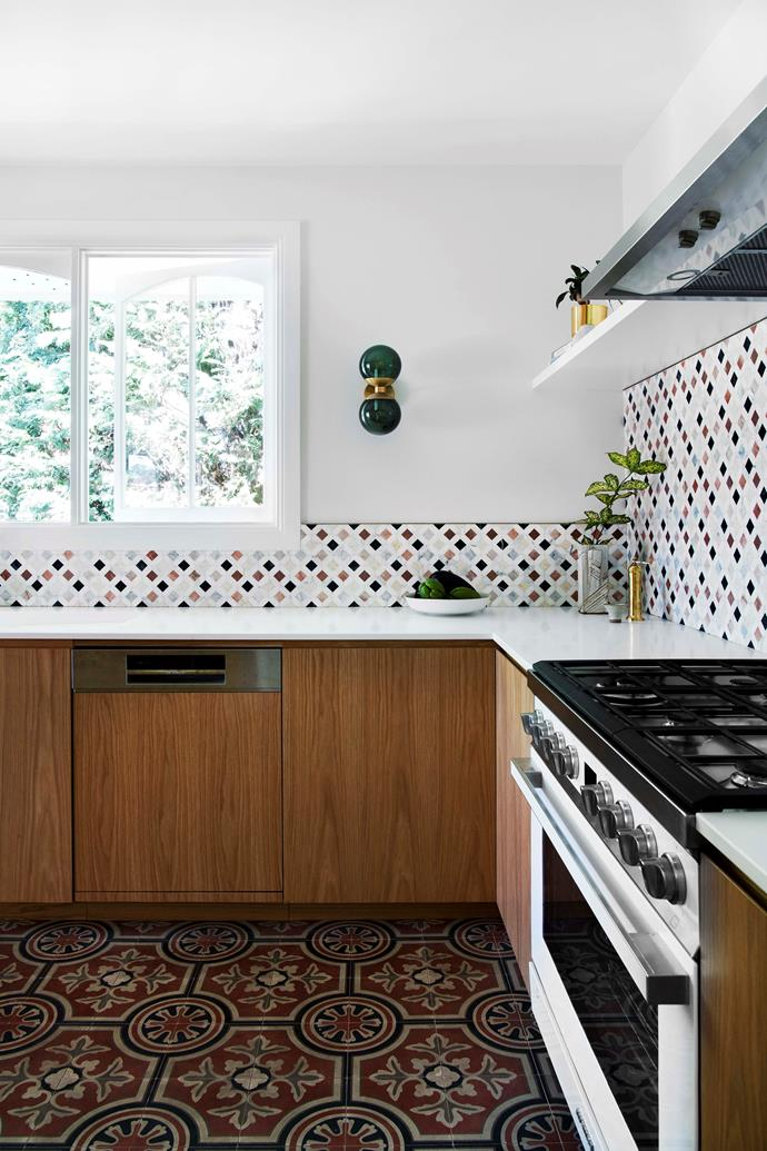Stepping into the Moroccan-style kitchen, it's hard not to expect an aromatic tagine to emerge from the sleek Bosch oven. Splashback tiles, Teranova. Floor tiles, Tiles by Kate. Emerald wall sconce, Douglas & Bec.