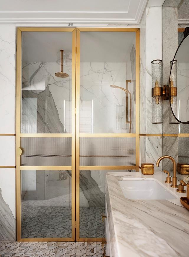 """Greg Natale selected a mosaic of Thassos and Carrara marble with a brass inlay from Teranova for the floor in this glamorous [art deco-inspired ensuite](https://www.homestolove.com.au/greg-natale-art-deco-inspired-home-hunters-hill-22330 target=""""_blank"""")."""