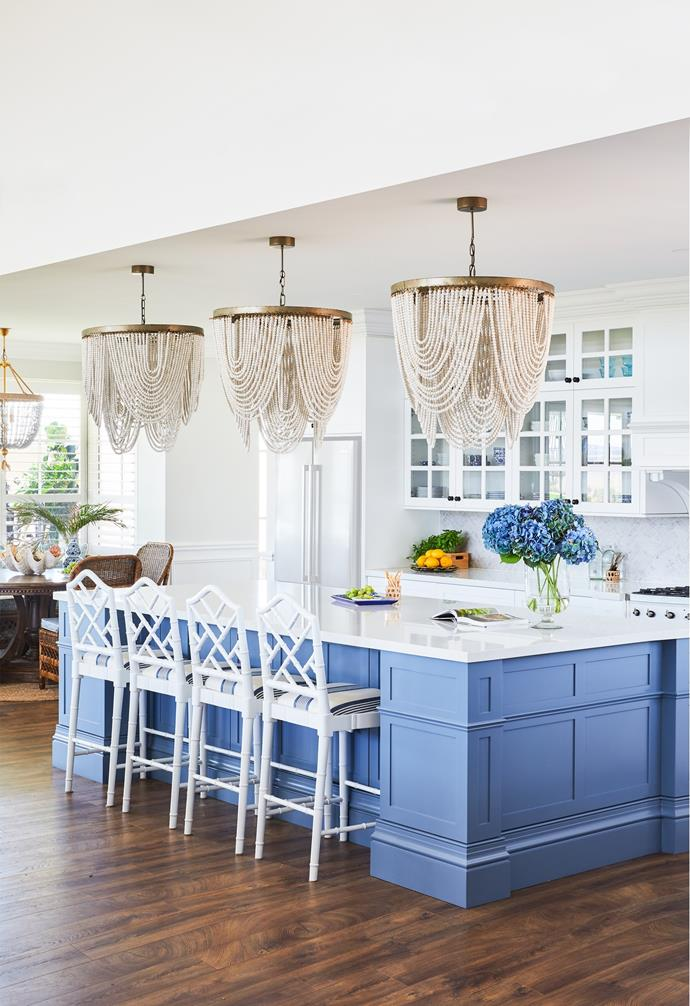 """Keen to create something different rather than """"cookie cutter"""", the couple's starting point for the kitchen design was a trio of bespoke timber-beaded chandeliers, available through Indah Island, which form a dramatic focal point above the three-metre [island bench](https://www.homestolove.com.au/timber-island-bench-ideas-21862