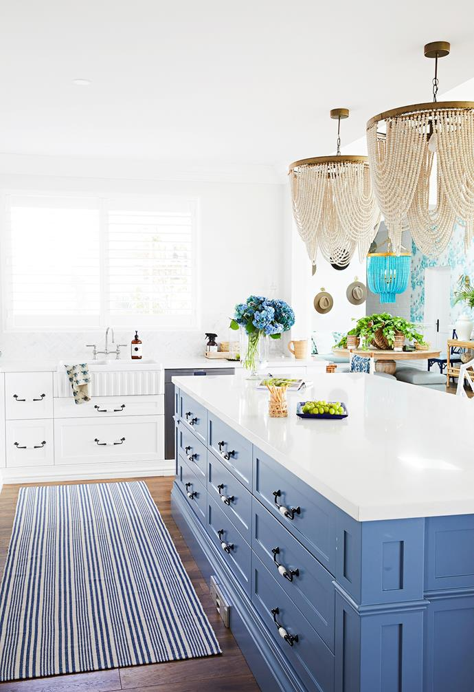 """Choosing the perfect shade of blue for all the elaborate custom under-bench joinery was also critical – Natalee deliberated for several months before choosing Saxby Blue. """"Because the space is connected to several eating areas and the main living area, it needed to be just right so it worked with all the surrounding blues and greens,"""" she explains."""