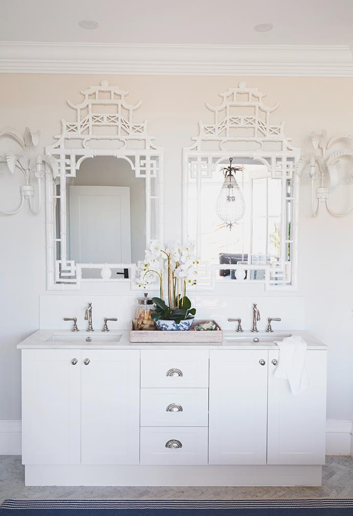 """Natalee wanted to make the ensuite """"really spectacular and special"""". Herringbone Soho Carrara tiles from Beaumont Tiles provide a sophisticated foundation for the roomy bathtub from Schots Home Emporium with 'Neu England' Brodware taps, which is positioned by the verandah to soak up rural views."""