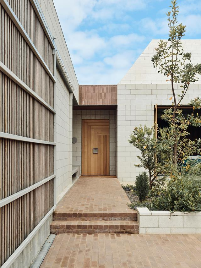 """Albert Mo of Architects EAT has sculpted a cool and cocooning retreat in concrete and brick. The [Mornington Peninsula abode](https://www.homestolove.com.au/robust-home-mornington-peninsula-22602 target=""""_blank"""") has been enlivened by vibrant furniture and striking contemporary art curated and commissioned by Swee Lim."""