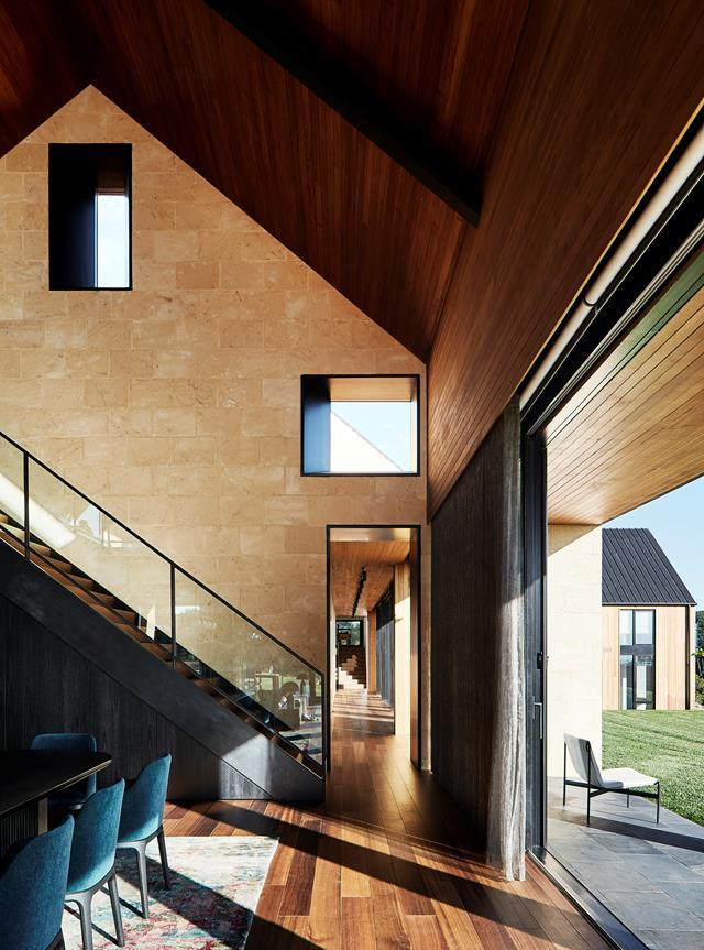 """Lavishly endowed with glowing Australian timber and limestone, this [home](https://www.homestolove.com.au/luxe-barn-home-22525 target=""""_blank"""") has a robust but luxe materials palette """"from the earth"""", says Abe McCarthy of Abe McCarthy Architects. Abe collaborated with interior designer Alice Villella of AV-ID, custom builders Gstruct Group and landscaper Barber Design to establish this warm, inviting family home embedded in open pastures on the Mornington Peninsula."""