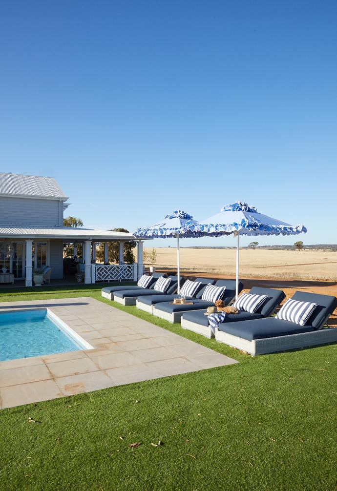 For an effortless green lawn, synthetic turf from Urban Turf envelops the Hamptons Blue Pool by Aqua Technics, which is defined by Horizon Light Grey tiles from Beaumont Tiles. A row of Osier Belle loungers creates a relaxing spot for pool parties and frilly 'Flamenco' umbrellas by Santa Barbara Designs, from 3Beaches, provide plenty of shade in the prettiest way possible.