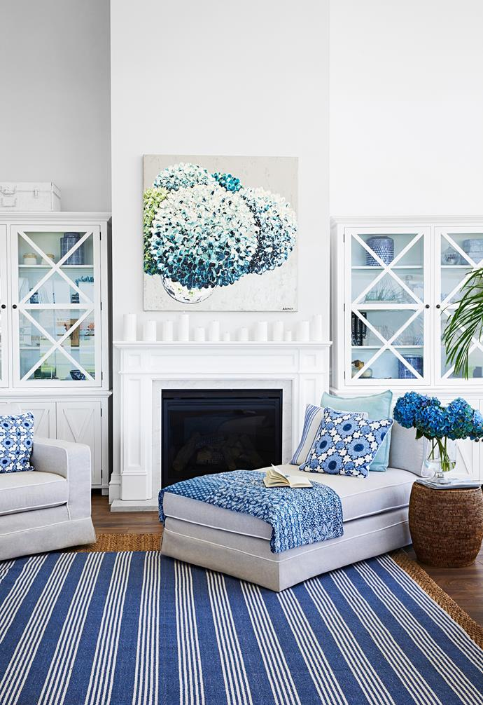 There's no TV in the home, instead rooms such as the living area are designed as social spaces to gather and enjoy simple pleasures, including sitting by the gas fireplace from Fireplace Corner, or stretching out on a comfy Molmic chaise with a good book. Big, blowsy hydrangeas are synonymous with the Hamptons and are also one of Natalee's favourite flowers, so the 'Club Hamptons' artwork by Felicia Aroney takes pride of place above the charming fireplace mantel from Schots Home Emporium. The striped Carnival Homewares rug adds classic formality, while the patterned fabrics provide interest and depth.