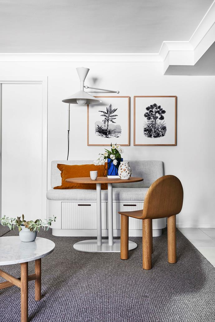 """The new dining 'nook' is a handy spot to eat in or to sit and look at a laptop. Josie designed the banquette storage to be topped with an upholstered bench seat. """"It's curved on both sides, so you can walk around it without worrying about angular edges,"""" she says."""