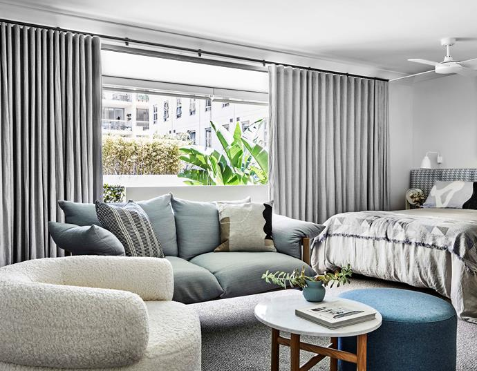 """To create a [comfortable living zone](https://www.homestolove.com.au/lounge-room-ideas-21182 target=""""_blank""""), Josie chose a comfy Wilfred sofa from [Jardan](https://www.jardan.com.au/ target=""""_blank"""" rel=""""nofollow"""") and teamed it with a textured armchair from Sara Ellison's furniture collection. """"To me, the Jardan sofa is the epitome of relaxed Australian design,"""" she says. The chunky wool-look carpet adds more texture and comfort underfoot. [Blockout curtains](https://www.homestolove.com.au/buyers-guide-to-curtains-and-blinds-9777 target=""""_blank"""") were installed to help insulate the apartment."""