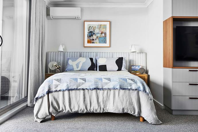 The panelled, padded headboard is wrapped in soft blue Cremaillere linen fabric by Christopher Farr. Artwork above bed by Pamela Honeyfield.