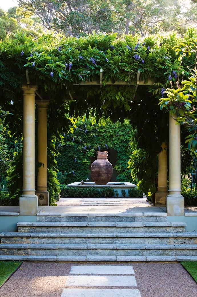 """A pergola in the central courtyard in this [hydrangea garden in Margaret River](https://www.homestolove.com.au/hydrangea-garden-design-13870