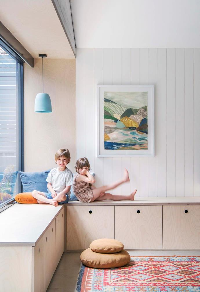 """A simple, rim of building in storage also serves a double purpose as a useful seating option in Oliver and Willow's playroom in their [Nordic-style Adelaide home](https://www.homestolove.com.au/nordic-style-timber-clad-family-home-in-adelaide-19016