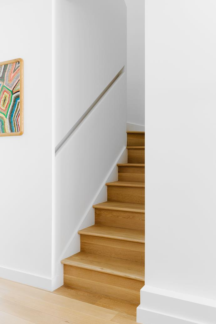 The stairs lead up to the master bedroom.