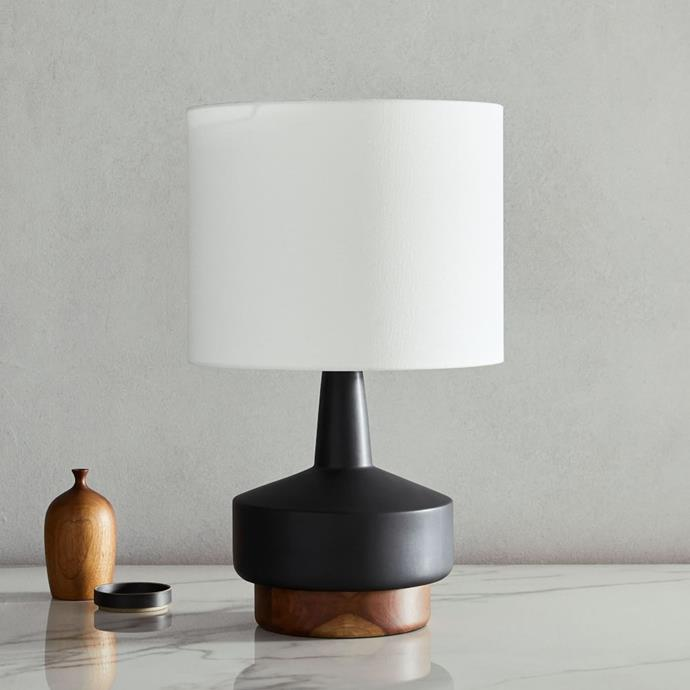 """Another elegant option for a mid-century modern home, this handsome lamp from West Elm would not be a wallflower in your living room. With a ceramic and timber base and and simple white shade, it's the perfect lighting option to fill an empty space on your sideboard.   **Wood & Ceramic Table Lamp, $239 - $299, [West Elm](https://www.westelm.com.au/wood-ceramic-table-lamp-medium-13-w3628