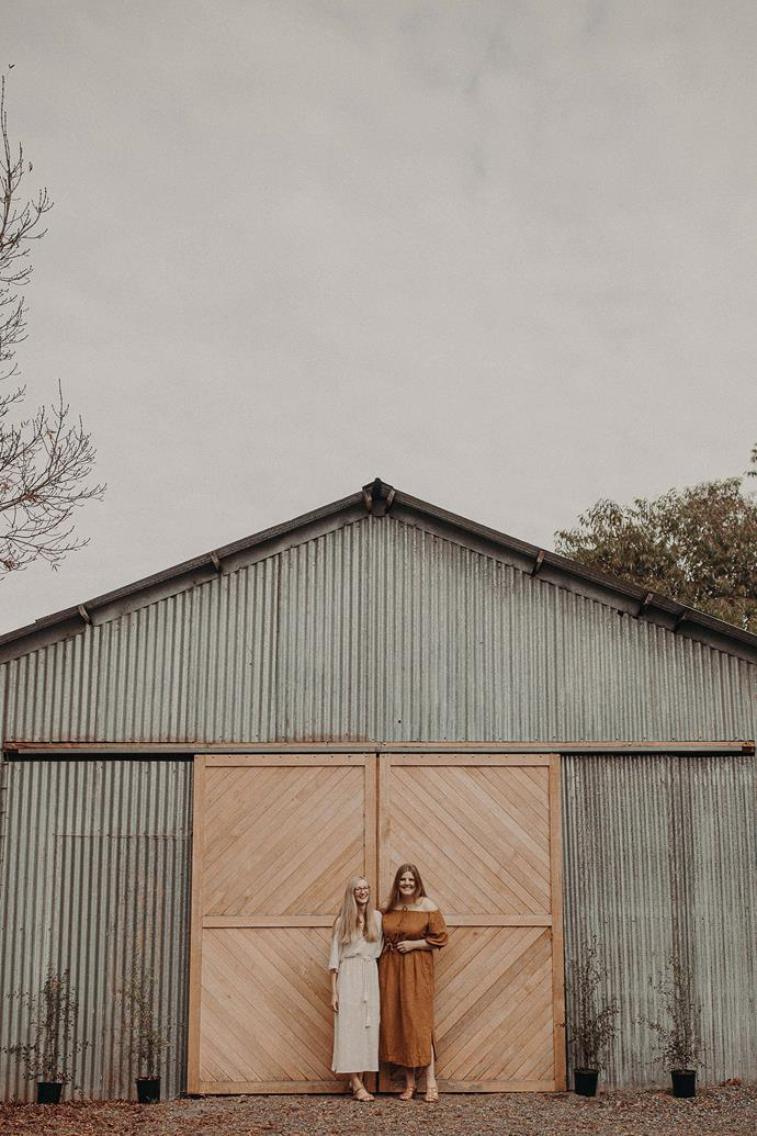 """Mel and Eliza out the front of their refurbished barn where they hold many of their workshops. """"We did most of the internal work ourselves,"""" says Eliza."""