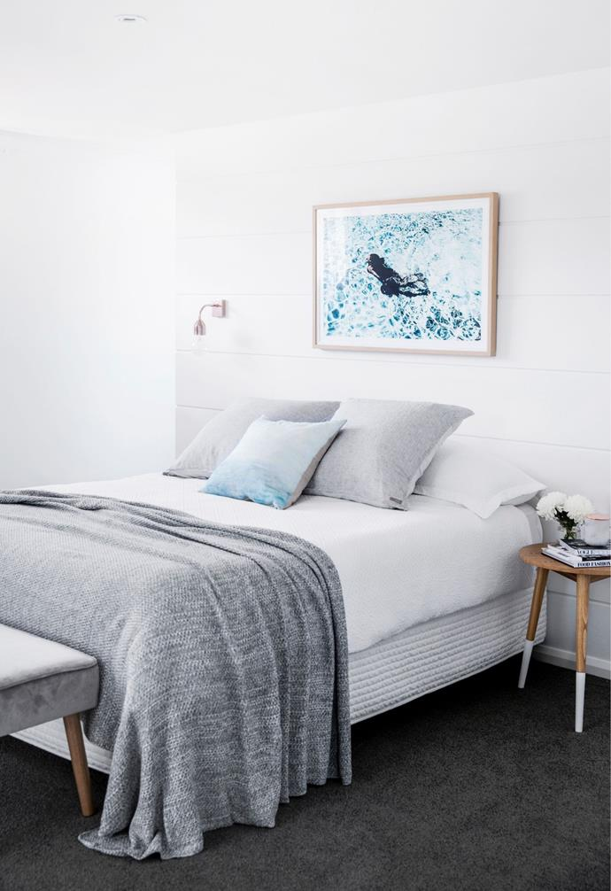 The wall behind the bed is painted in Taubmans' Snow Drop.