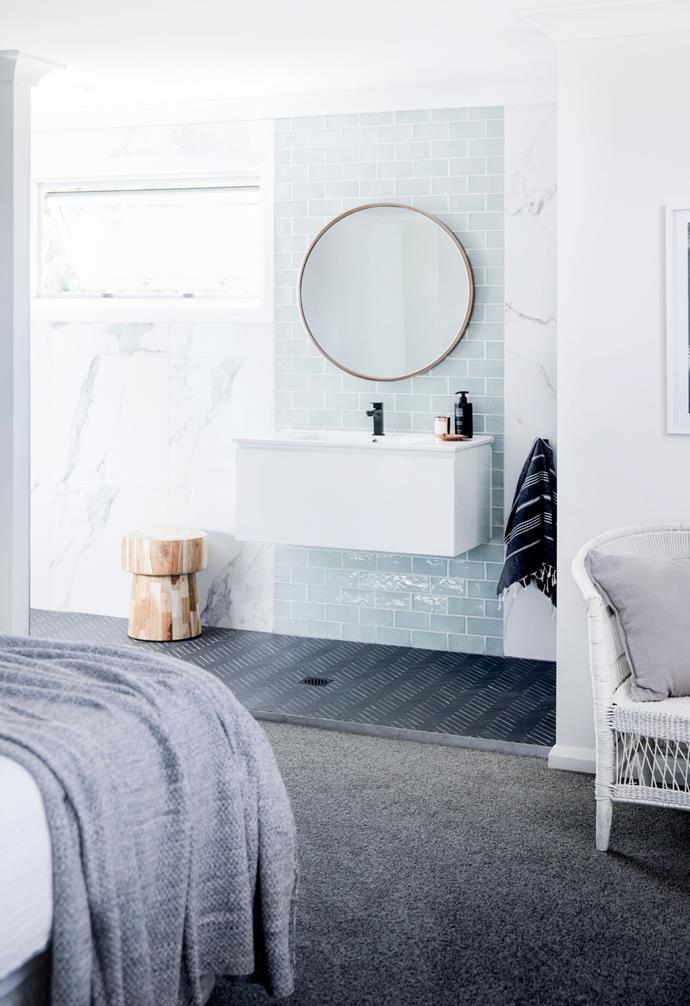 The bathroom has used 'Menta' 150mm x 75mm tiles from Amber Tiles, Durastone 50mm x 25mm herringbone floor tiles and 'Statuario' 600mm x 600mm wall tiles, both from Amber Tiles.