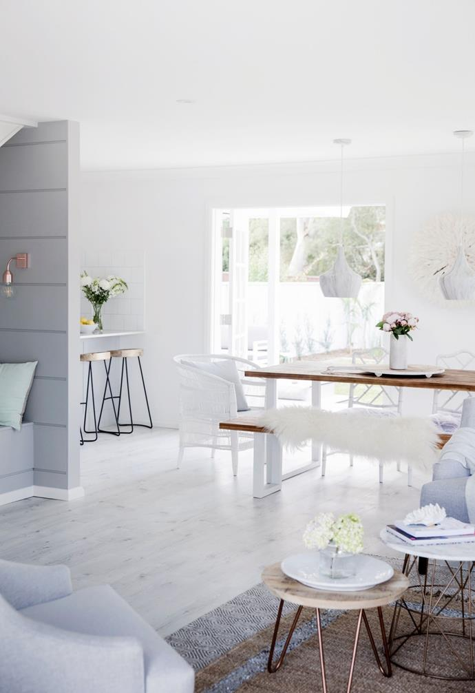 Pale flooring in the shape of Formica 12mm laminate in Whitewash Oak from Bunnings unifies the space and amps up the light factor.