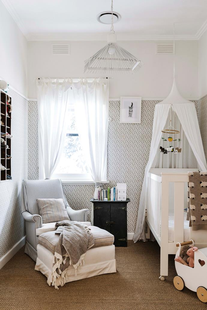 Bec retained the original wallpaper in the nursery, and re-covered an antique chair from her parents-in-law.