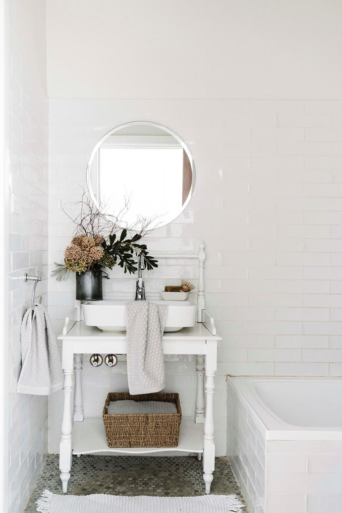 The bathroom was on of the first rooms renovated, with its tired pink and green scheme replaced by grey and white.