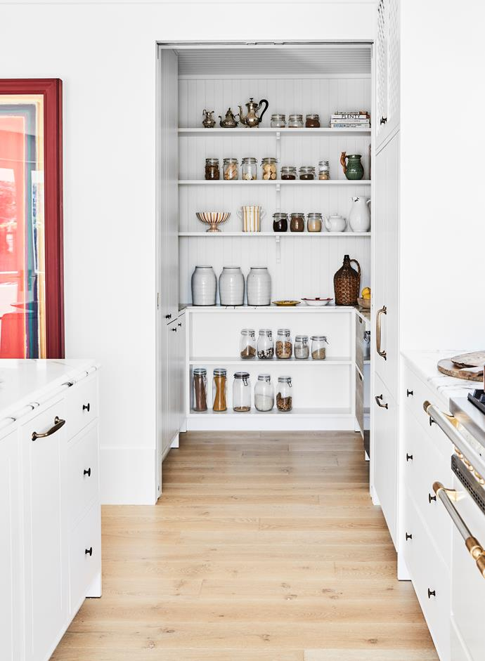 A Bosch Series 8 dishwasher and Fisher & Paykel fridge are concealed behind joinery, while the pantry includes a Vintec wine cabinet.Artwork by Tomislav Nikolic, Fox Jensen.