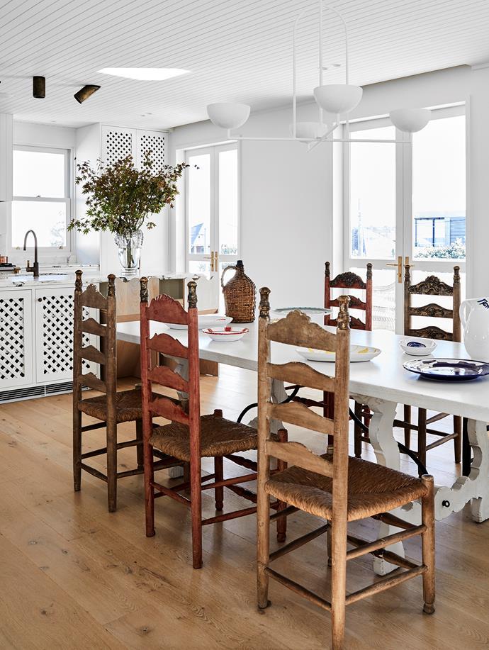 Custom dining table, Chatsworth Fine Furniture. Tableware, Alex and Trahanas. Antique Spanish dining chairs, The Vault Sydney. Pendant light, Anna Charlesworth.